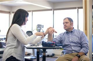Therapist Adjusting Adult Male Wrist