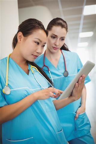 Nurses Using Digital Tablet