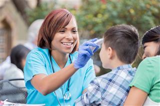 Nurse Checks Young Patients Temperature