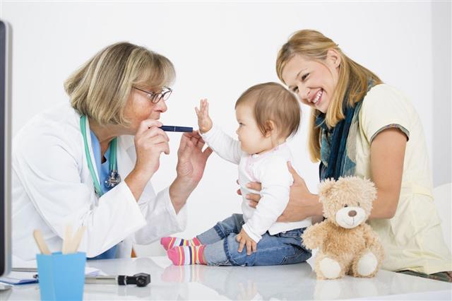 Pediatrician Checking Eyesight Of An Girl