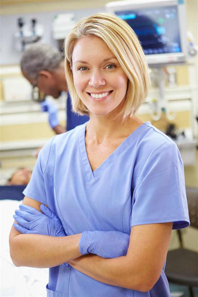 Nurse Working In Emergency Room
