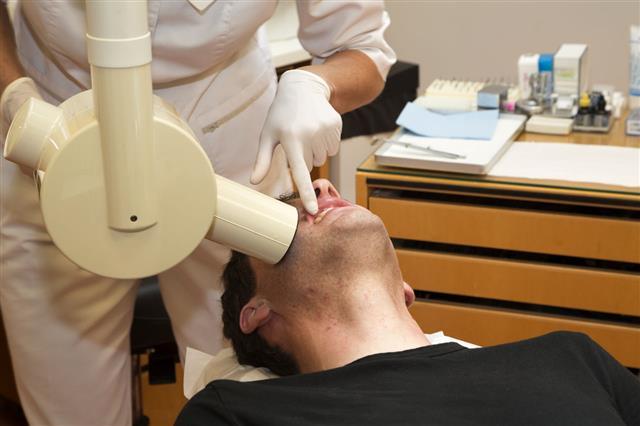 Female Dentist Taking An X Ray
