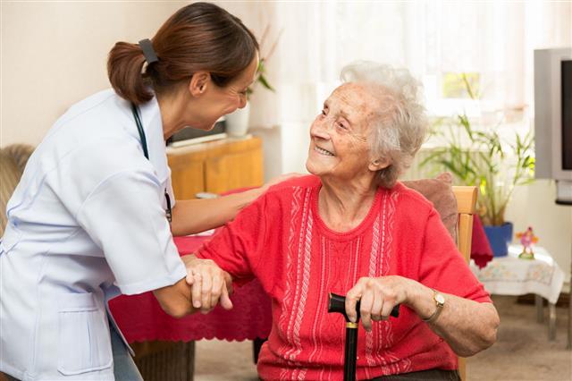 Female Nurse With Senior Woman Patient