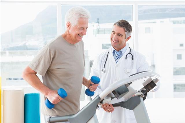 Senior Man On Treadmill With Therapist