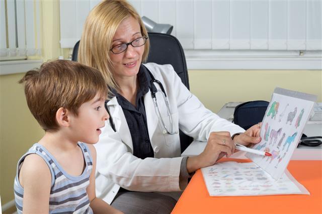 Doctor Examining A Boy In Hospital