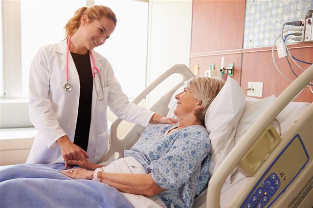 Doctor Talks To Senior Patient
