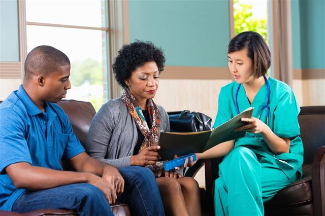 Home Healthcare Nurse Talking To Patient