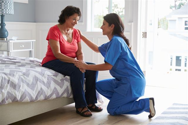 Nurse Making Home Visit Senior Woman