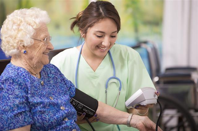 Home Nurse Checks Blood Pressure