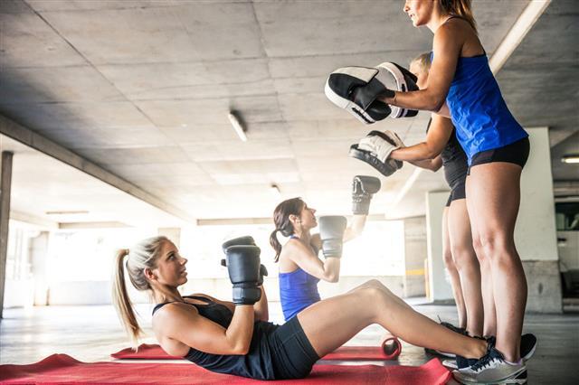 Women Boxing Team Exercising Outdoor