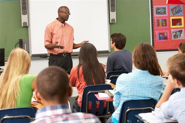 Teacher Using Whiteboard During Class