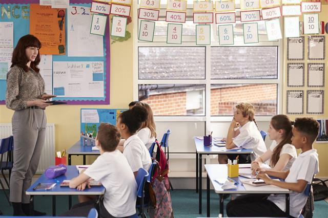 Teacher Using Tablet During A Class