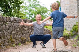 Son Runs To His Father