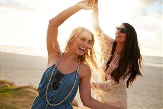 Two Young Women Enjoying Beach Vacation