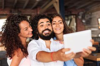 People Making Selfie At Bar