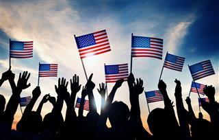 Group Of People Waving American Flags
