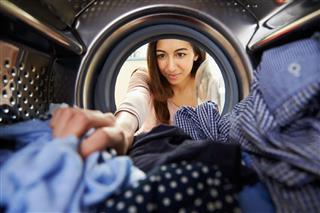 Woman Doing Laundry Reaching