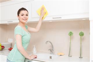 Beautiful Young Lady Washing Kitchen