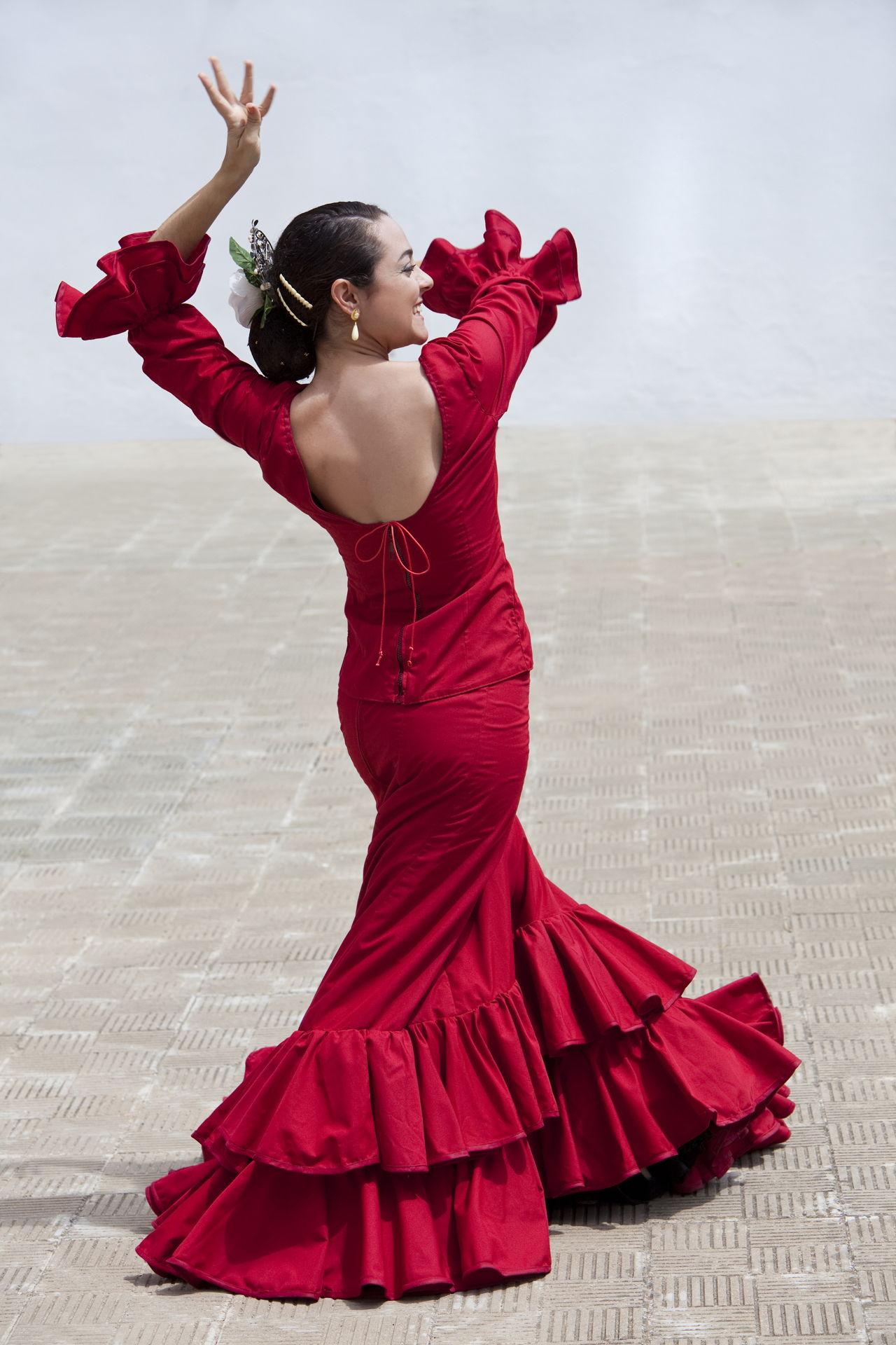 Spanish Flamenco Dancer In Red Dress on Tango Steps For Beginners