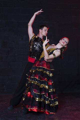 Young Couple Dancing Flamenco