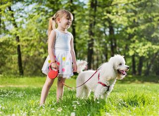 Little Girl Enjoying With Her Dog