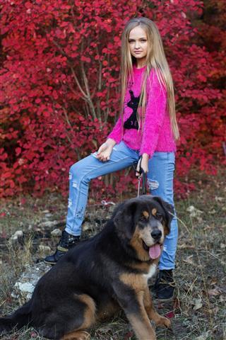 Pretty Blonde Girl With Mastiff
