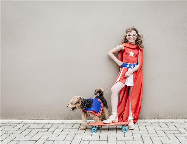 Little Superhero Girl With Her Dog