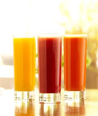 Three Tall Glasses Of Juice