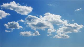 Cumulus Cloudscape With Sun