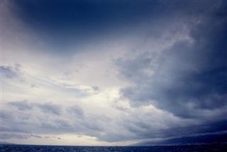 Cumulus Clouds Over The Sea