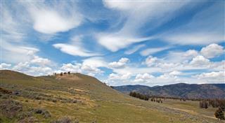Rolling Hills Under Cirrus Lenticular Cloudscape
