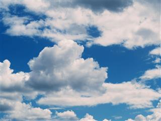 White Cumulus Clouds In Blue Sky