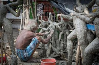 Man Making Hindu Idol