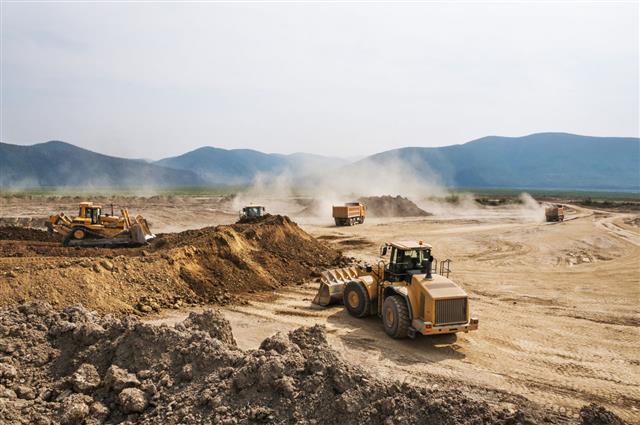 Bulldozers Digging Soil