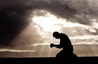 Middle Aged Man Praying