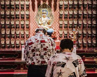 People Praying In Temple
