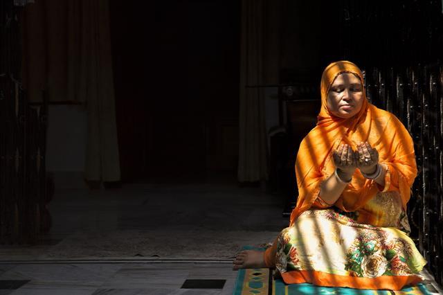Mid Adult Muslim Woman Praying