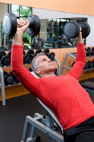 Mature Man Lifting Weights