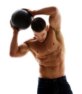 Shirtless Muscular Man Holding Medicine Ball