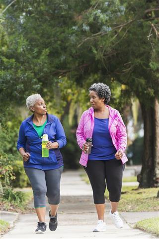 Two Senior Women Exercising Together