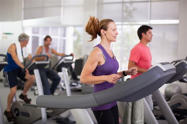 Woman On Treadmill In Gymnasium