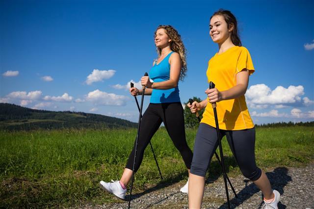 Young Women Nordic Walking