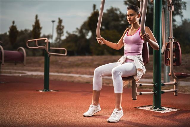 Young Female Athlete Exercising