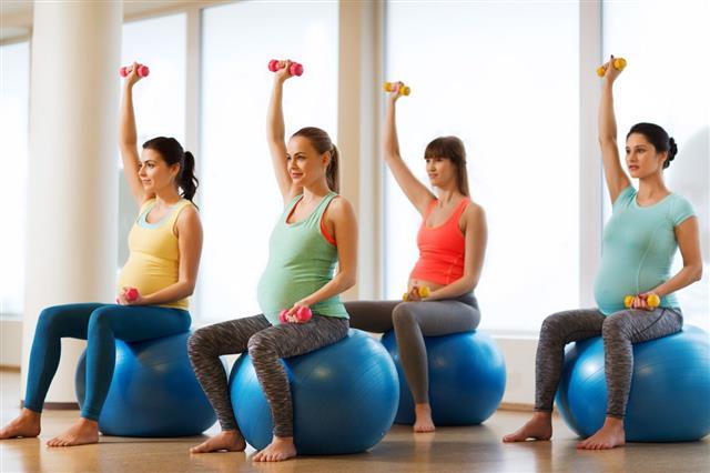 Happy Pregnant Women Exercising