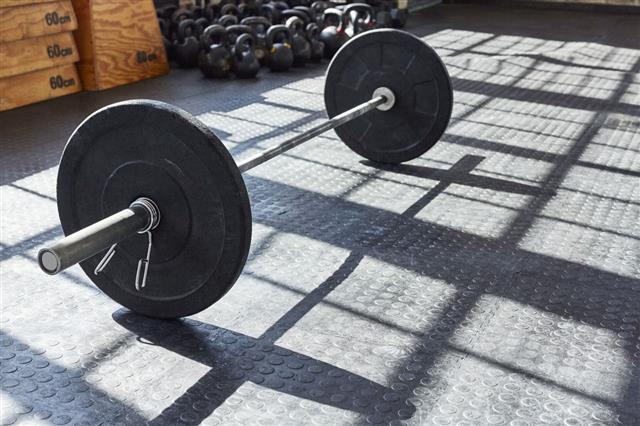 Black Barbell On Floor In Gym