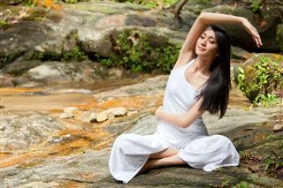 Beautiful Asian Lady Practicing Yoga