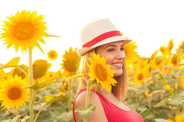 Beautiful Woman In A Sunflower Field