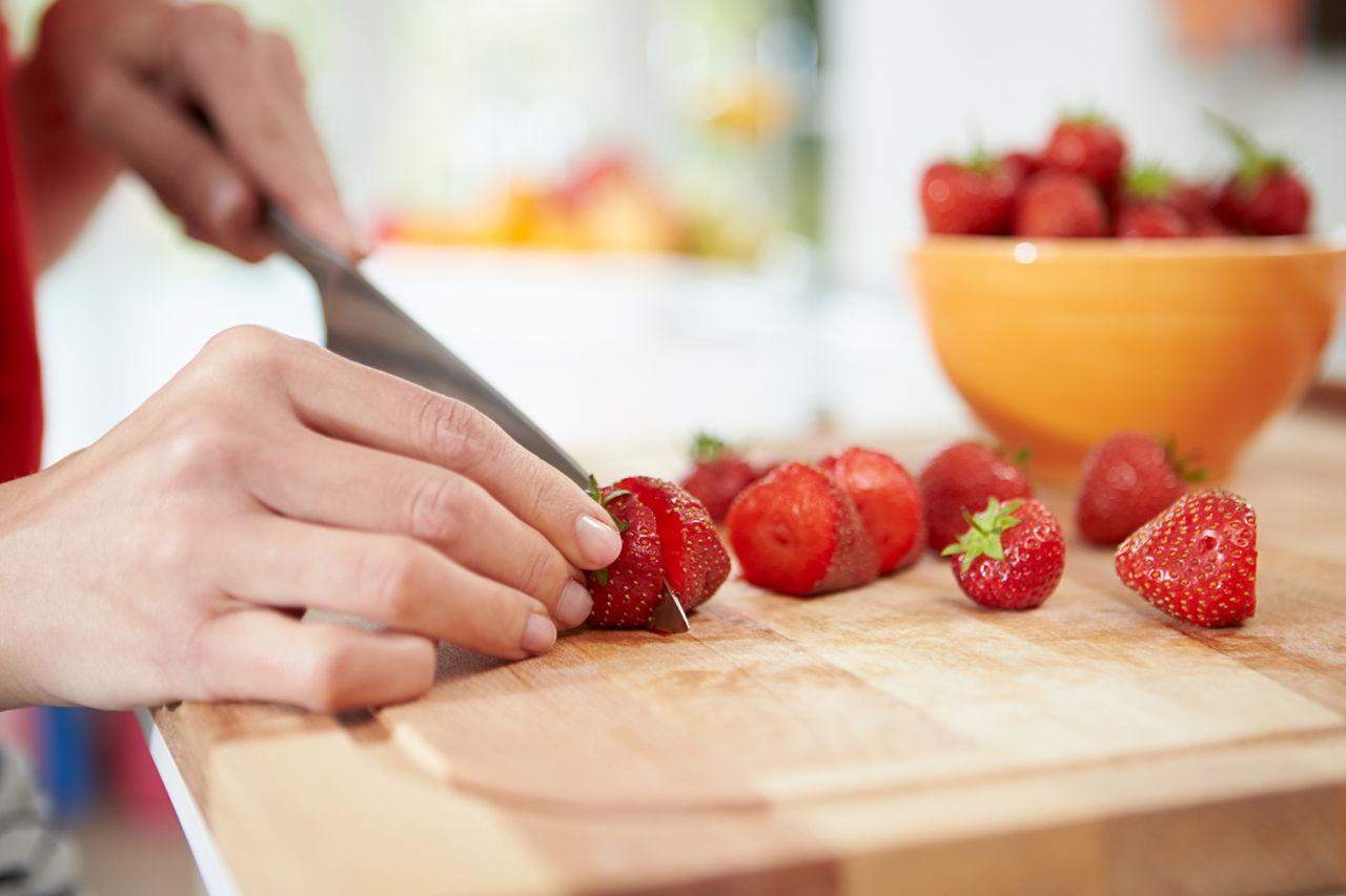 Woman Preparing Fruit Salad
