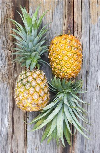 Pineapple On Wood Background