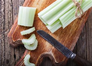 Celery Chopped On A Wooden Board